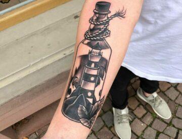 Bottle lighthouse Blutkunst Tattoo